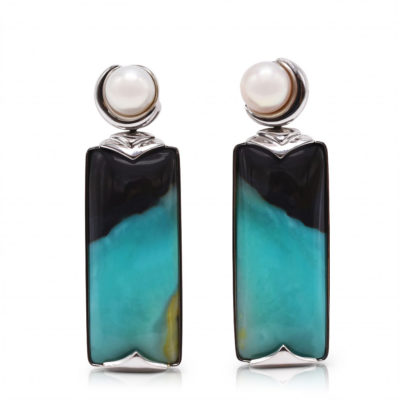 """Crescent"" earrings in 18 karat white gold featuring 35.45 carat pair of natural Opalized Wood and a pair of 7-7.5 mm Freshwater Pearl; the opalized wood is found in the West Java Province of Indonesia."