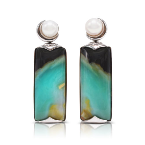 """""""Crescent"""" earrings in 18 karat white gold featuring 34.78 carat pair of natural Opalized Wood and a pair of 7-7.5 mm Freshwater Pearl; the opalized wood is found in the West Java Province of Indonesia."""