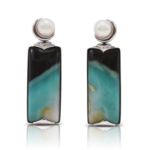 """""""Crescent"""" earrings in 18 karat white gold featuring 34.65 carats pair of natural Opalized Wood and a pair of 7-7.5 mm Freshwater Pearl; the opalized wood is found in the West Java Province of Indonesia."""