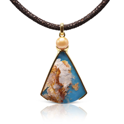 """One-of-a-kind pendant crafted in 18 karat yellow gold featuring a 57.65 carats, fan-shaped """"Coral Sea Turquoise"""" accented by a 11.5 mm Golden South Sea Pearl."""
