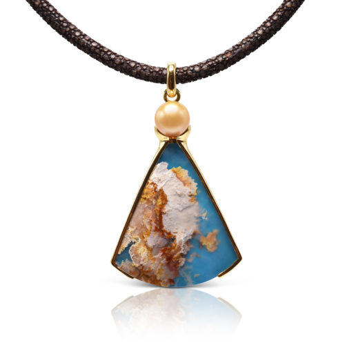 """One-of-a-kind pendant crafted in 18 karat yellow gold featuring a 57.65 carat, fan-shaped """"Coral Sea Turquoise"""" accented by a 11.5 mm Golden South Sea Pearl."""