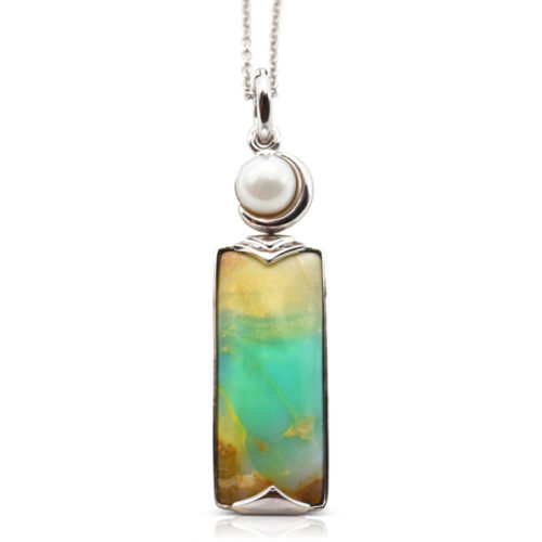 Crescent pendant in 18-karat white gold featuring 8.69 carats natural Opalized Wood and 7-7.5 mm Freshwater Pearl; the opalized wood is found in the West Java Province of Indonesia.