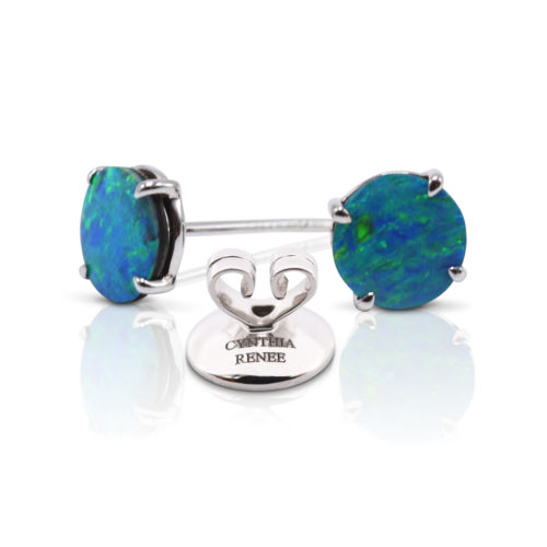 Elegant stud earring in a hand-crafted 18 karat white gold setting featuring pair of 1.89 carat Black Opal doublets; opals measure 7-mm round.
