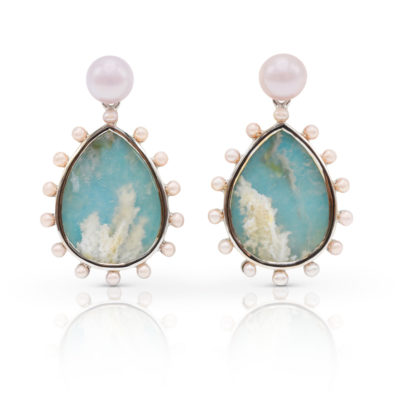 "Phoenix earring in 18 karat white gold featuring 15.56 carat pair of ""Coral-Sea Turquoise"" haloed by 2-mm freshwater pearls suspended from a 7-mm luminous, freshwater pearl stud."