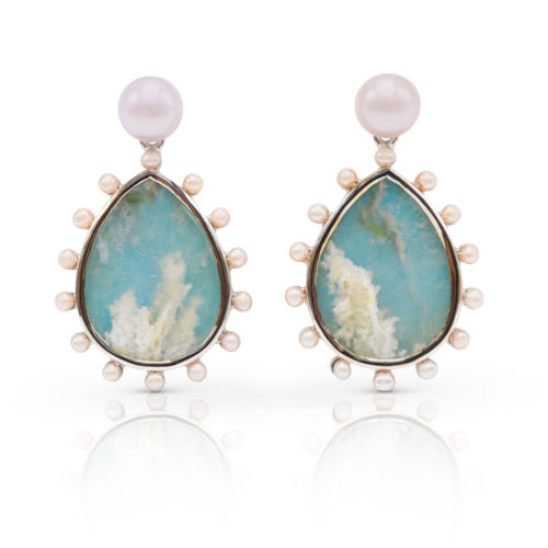 """Phoenix earring in 18 karat white gold featuring 15.56 carat pair of """"Coral-Sea Turquoise"""" haloed by 2-mm freshwater pearls suspended from a 7-mm luminous, freshwater pearl stud."""