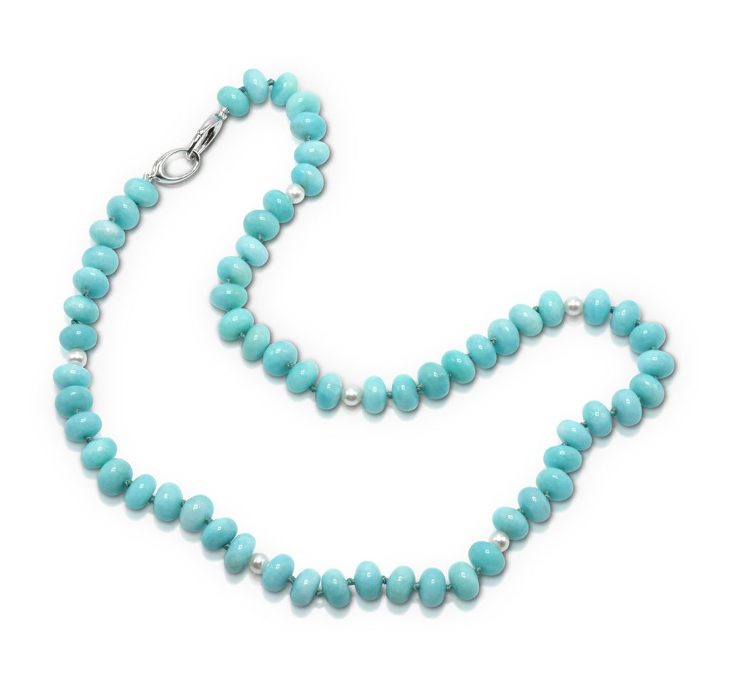 Bead Necklace consisting of 61 pieces of 10x7-mm smooth Amazonite (Peru-N) rondell shaped beads strung with six-5-mm freshwater pearls on knotted thread with 14-karat white gold double triggerless clasp; 21 inches long.