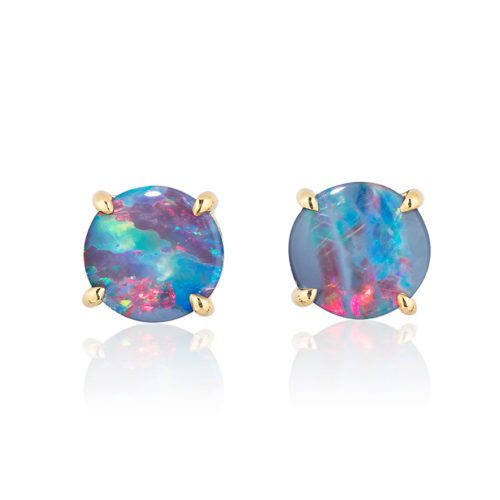 Elegant stud earring in a hand-crafted 18 karat yellow gold setting featuring pair of 1.63 carats Black Opal doublets; opals measure 7-mm round.