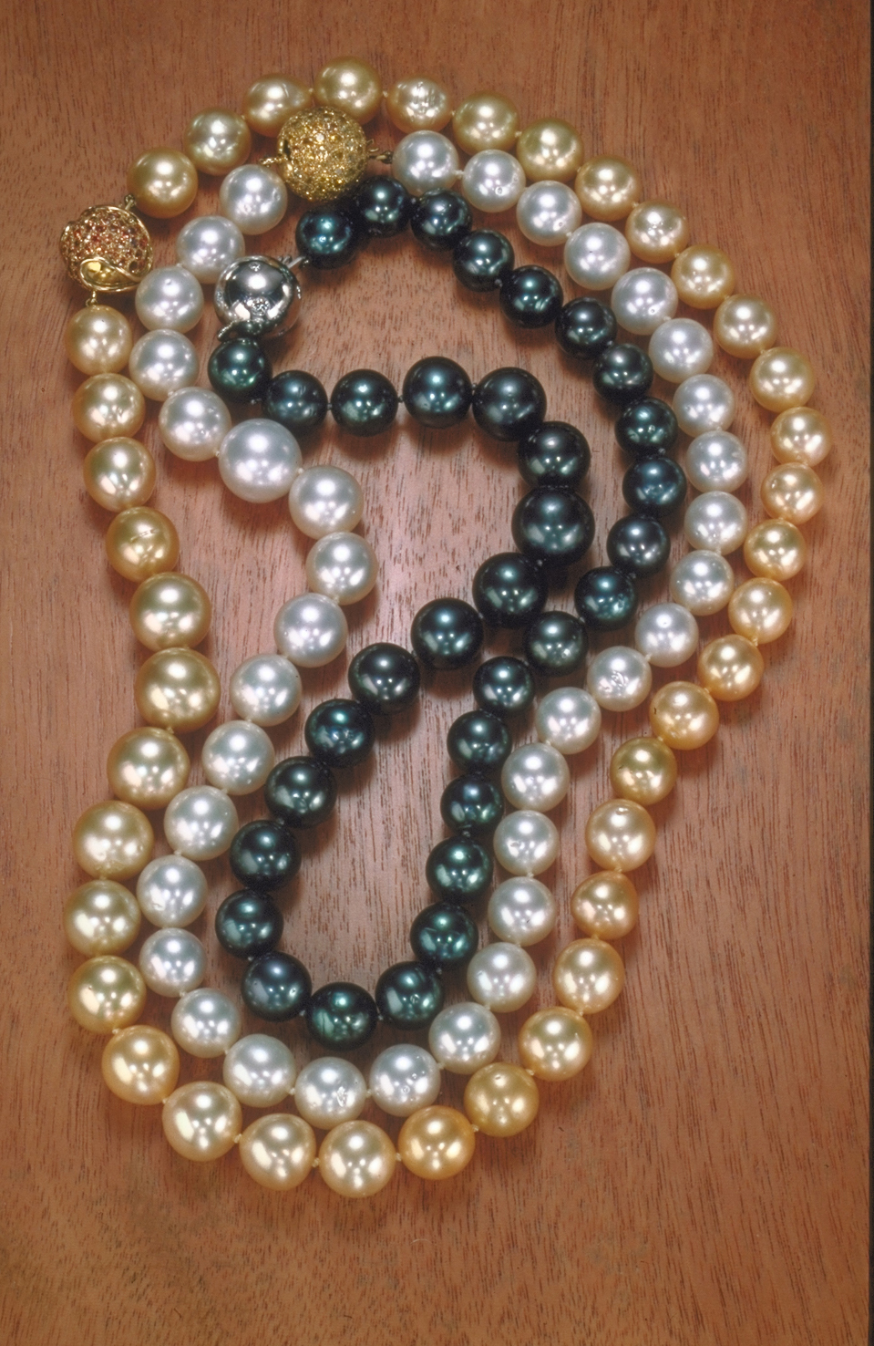 Three strands of Tahitian black, South Sea white, and gold pearls and Philippines  necklaces