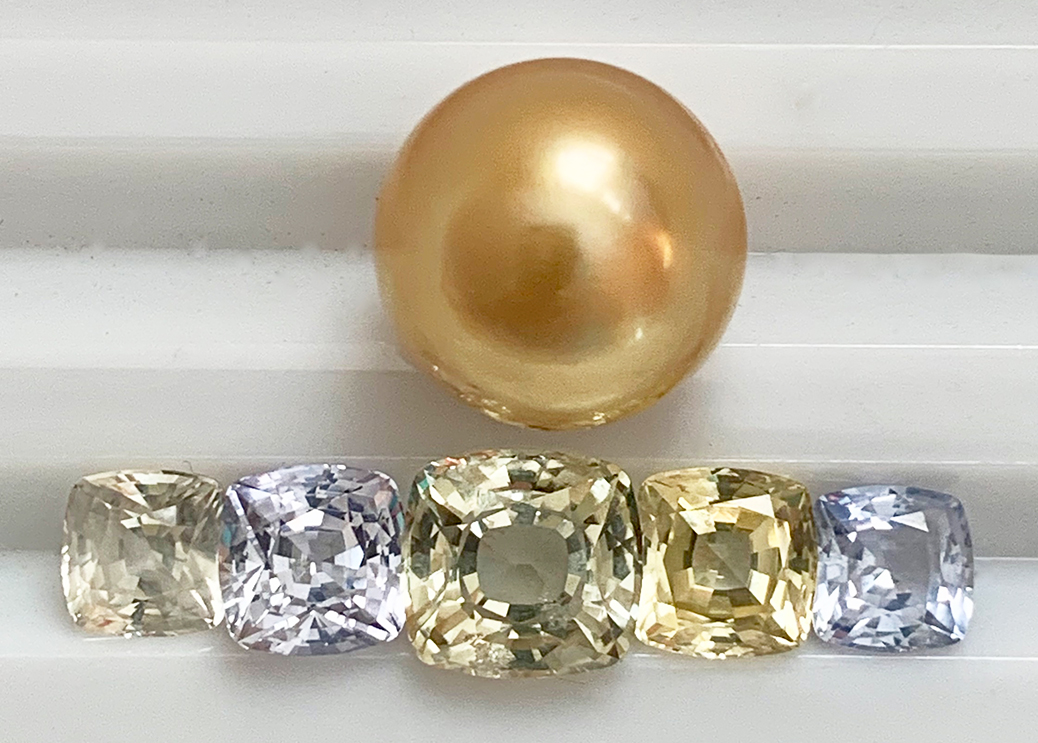 Golden pearl with pastel sapphires