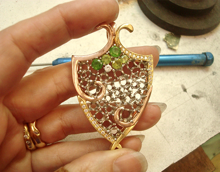 The palladium baskets soldered together and set inside the frame, with a few gems set in the baskets.