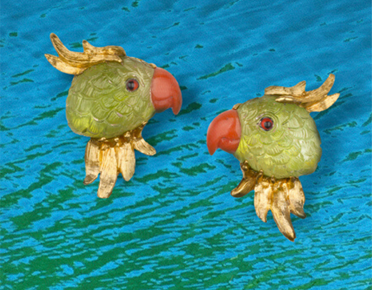 """Joy"" earrings in 18-karat yellow gold featuring hand-carved Peridot parrots with Coral beaks."