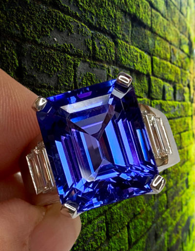 """""""Step by Step"""" - Cynthia Renee Full Custom Design Ring in 14 karat white gold featuring 16.79 carat Tanzanite accented by six diamond baguettes weighing a total of 1.37 carats."""