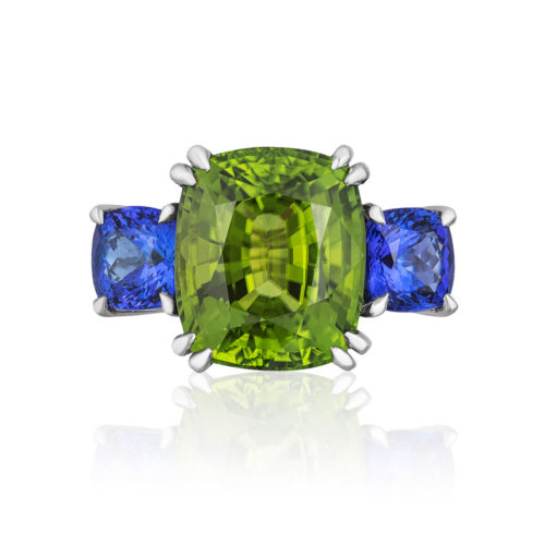 """Heaven & Earth"""" 3-stone ring in palladium featuring stunning 16.58 carats. Burmese Peridot accented by 4.75 carat pair of Tanzanite"""