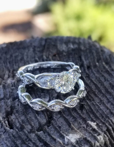 """""""Growing Together"""" ~ Cynthia Renee Full Custom design wedding set featuring 1.02 carat center diamond flanked by 5x3 mm pear-shapes; the couple started and own a fabulous organic produce farm and the ring's twisting shapes represent plant tendrils."""