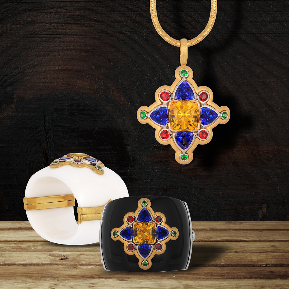 """""""Medallion Jewel"""" - Cynthia Renée full custom multi-purpose jeweled medallion featuring a 20.52 carat yellow danburite from Tanzania with 14 carats of tanzanite, 1.04 carats of tsavorite and 2.78 carats of red spinel. The jeweled portion can be worn in either of the custom made black or white cuffs or as a pendant. First Place winner for Custom Design Distinction in the MJSA Vision Awards 2017."""