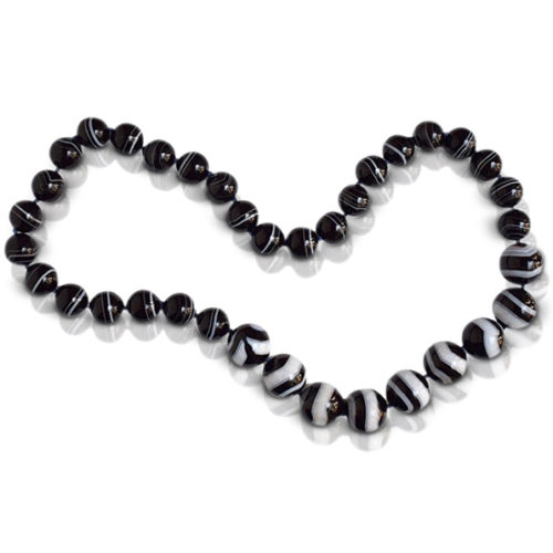 """Bead necklace consisting of 35 pieces of natural black and white """"Zebra"""" Sardonyx strung on knotted dark royal blue thread."""