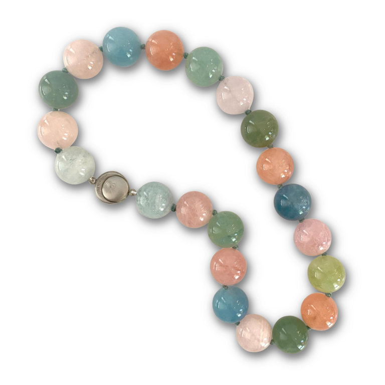Bead necklace of 21 pieces of 20 mm natural variegated Beryl on knotted blue thread with Cynthia Renee's magnetic