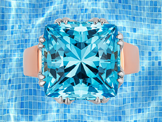 """""""Trellis Ring"""" featuring cushion-cut Blue Topaz set in 18 karat white gold basket with 18 karat rose gold shank."""