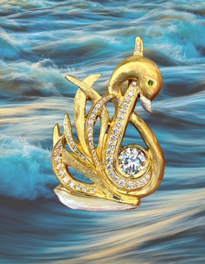 """""""Cigne Queen"""" ~ Cynthia Renée Full Custom Design Brooch in 18 karat yellow gold with platinum beak featuring client's 2.02 carat round diamond accented by 64 round brilliant diamonds weighing a total of 1.00 carats; the swan, with its tsavorite eye, glides on a natural wing pearl from the Tennessee River, USA."""